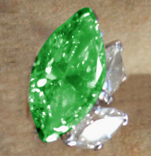 Enlarged photo of one of the stolen emerald earrings.